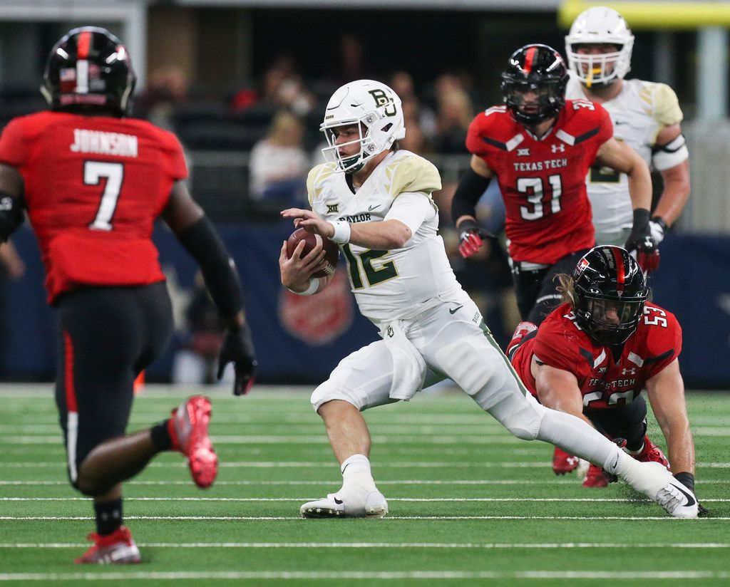 FILE - Baylor Bears quarterback Charlie Brewer (12) makes a break with the ball during the first half a matchup between Baylor and Texas Tech on Saturday, Nov. 24, 2018 at AT&T Stadium in Arlington, Texas. (Ryan Michalesko/The Dallas Morning News)