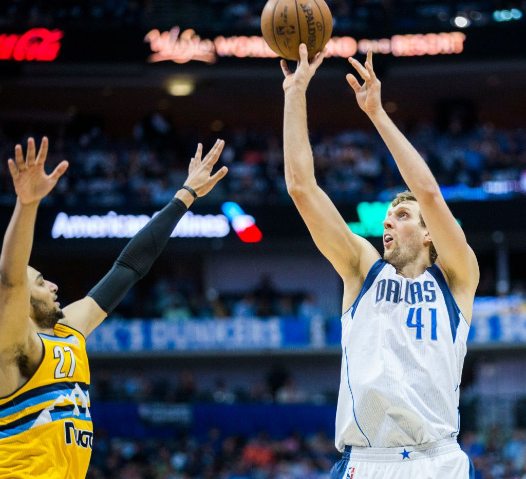 Dallas Mavericks forward Dirk Nowitzki (41) takes a shot over Denver Nuggets guard Jamal Murray (27) during the first quarter of an NBA game between the Dallas Mavericks and the Denver Nuggets on Tuesday, April 11, 2017 at the American Airlines Center in Dallas. (Ashley Landis/The Dallas Morning News)