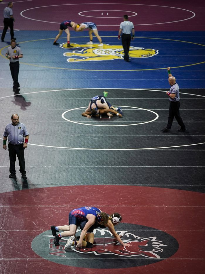 Wresters compete in a consolation round during the NCWA national championships at the Allen Events Center on Friday, March 13, 2020, in Allen, Texas.
