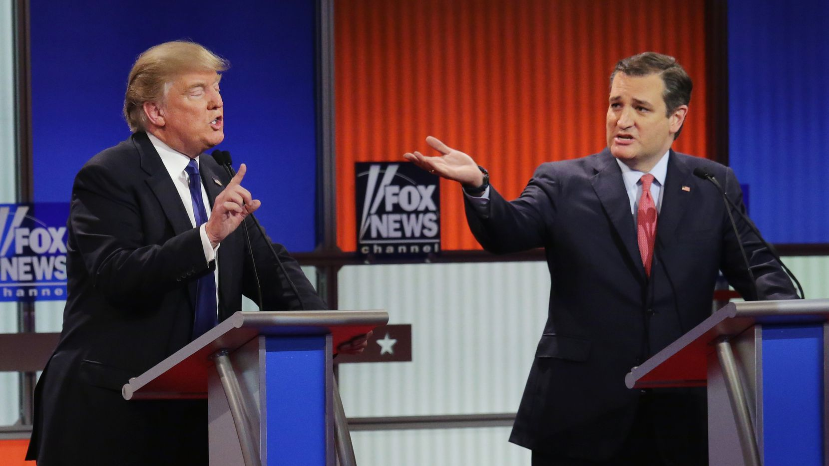 Republican presidential candidates (Lto R) Donald Trump and Sen. Ted Cruz (R-TX) participate in a debate sponsored by Fox News at the Fox Theatre on March 3, 2016 in Detroit, Michigan. Voters in Michigan will go to the polls March 8 for the State's primary.