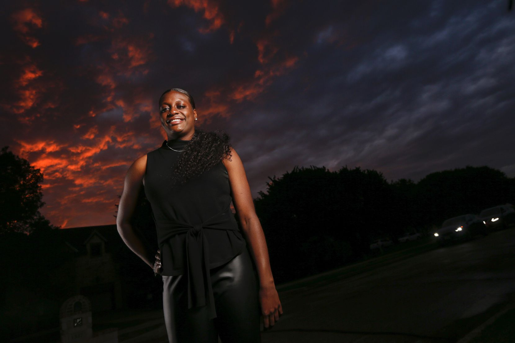 Joyner Holmes, formerly of Cedar Hill High School and the University of Texas, poses for a photograph outside her family's home after being drafted to the WNBA in the second round to the Seattle Storm on Friday, April 17, 2020, in Cedar Hill, Texas.