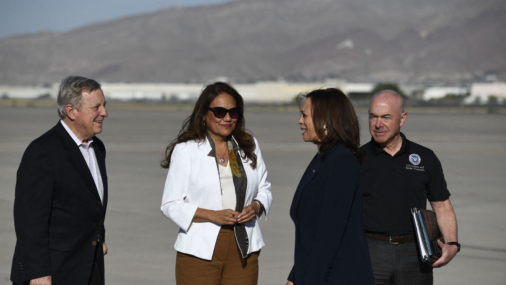 Vice President Kamala Harris speaks with Sen. Dick Durbin, D-Ill., Rep. Veronica Escobar, D-El Paso, and Homeland Security Secretary Alejandro Mayorkas upon arrival at El Paso International Airport on June 25, 2021, They flew together on Air Force 2 to tour the border and meet with migrant advocates.