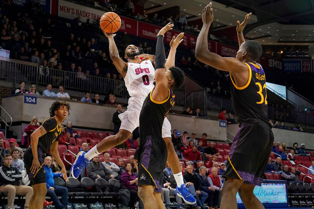 SMU guard Tyson Jolly (0) shoots over East Carolina forward Jayden Gardner (1) during the first half of an NCAA menÕs basketball game at Moody Coliseum on Wednesday, Jan. 22, 2020, in Dallas.