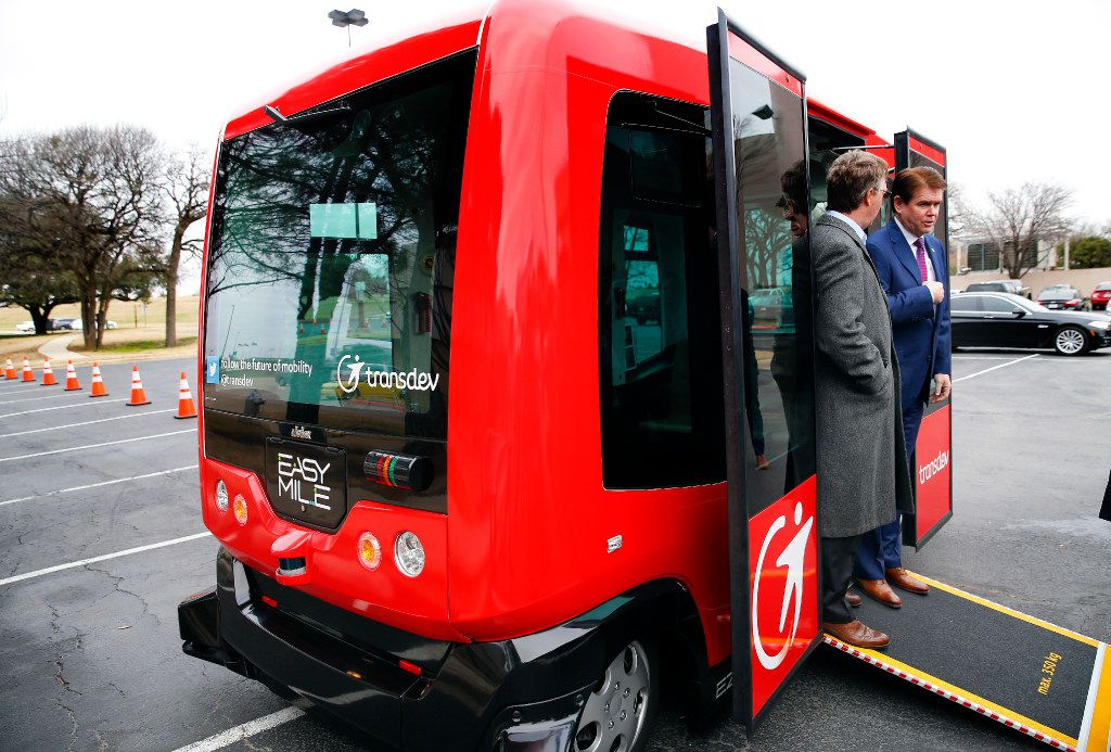 """Arlington Mayor Jeff Williams (right) and Deputy City Manager Jim Parajon rode a six-seat self-driving shuttle at the Arlington Convention Center, in Arlington, Texas, Thursday, February 2, 2017. Alliance for Transportation Innovation's  EZ-10 is a programmable shuttle that ferries passengers from a set location on a closed course. Arlington is gaining popularity as a testing ground for self-driving cars. Last week, the Department of Transportation named it a """"national Automated Vehicle Proving Ground."""" (Tom Fox/The Dallas Morning News)"""