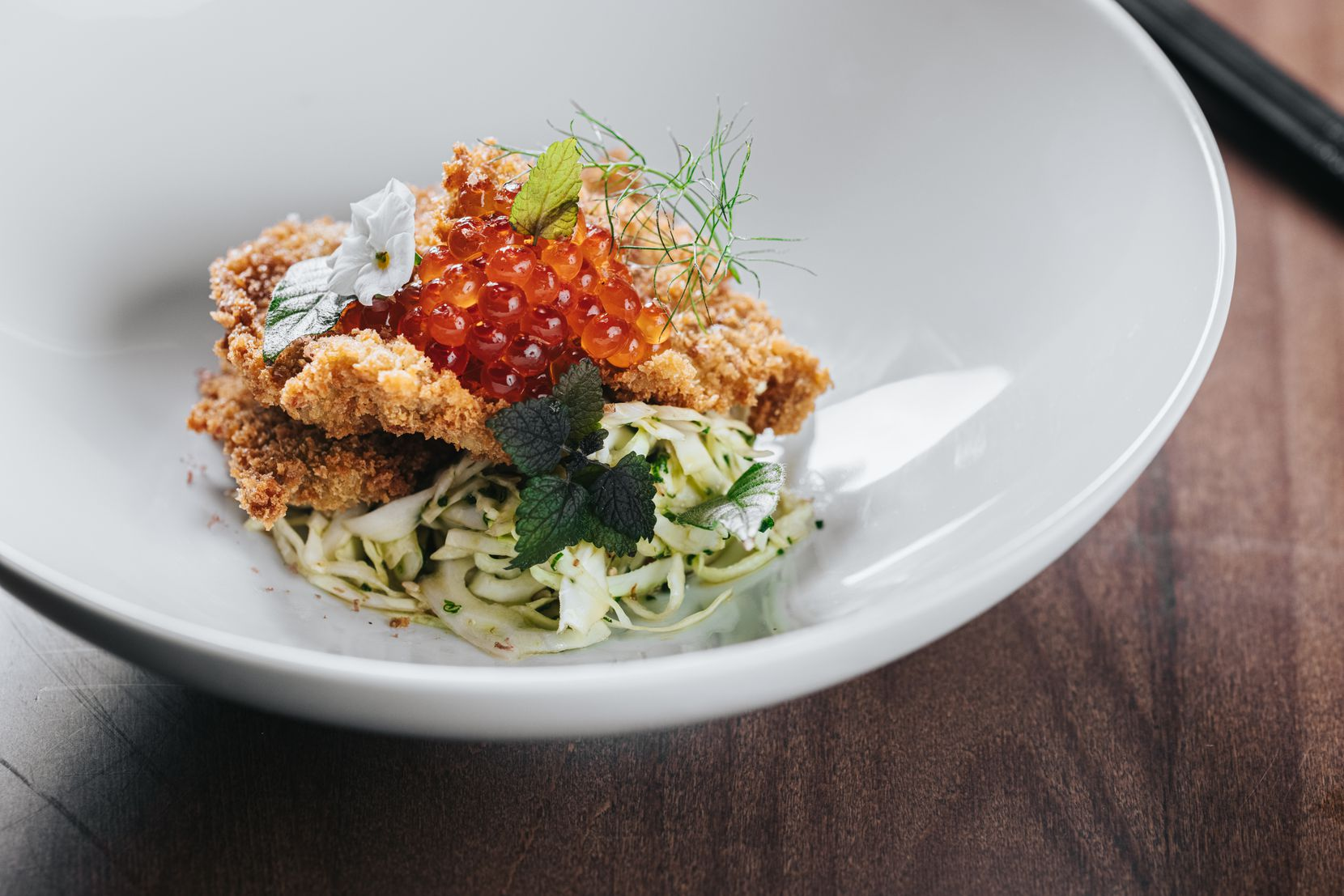 Ichi Ni San will have panko-fried oysters topped with red caviar on its menu. Ichi Ni San is a non-traditional Japanese restaurant from chefs Peja Krstic and Somnuk Gatesuwan in downtown Dallas' AT&T Discovery District.