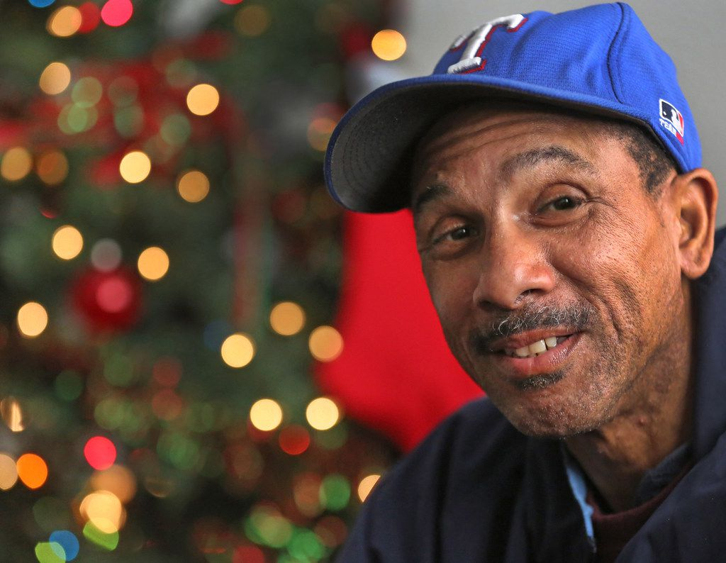 Willie Hodge is pictured in his apartment with his Christmas tree that he obtained when former tenants in the complex he maintains left a fully-decorated tree behind.