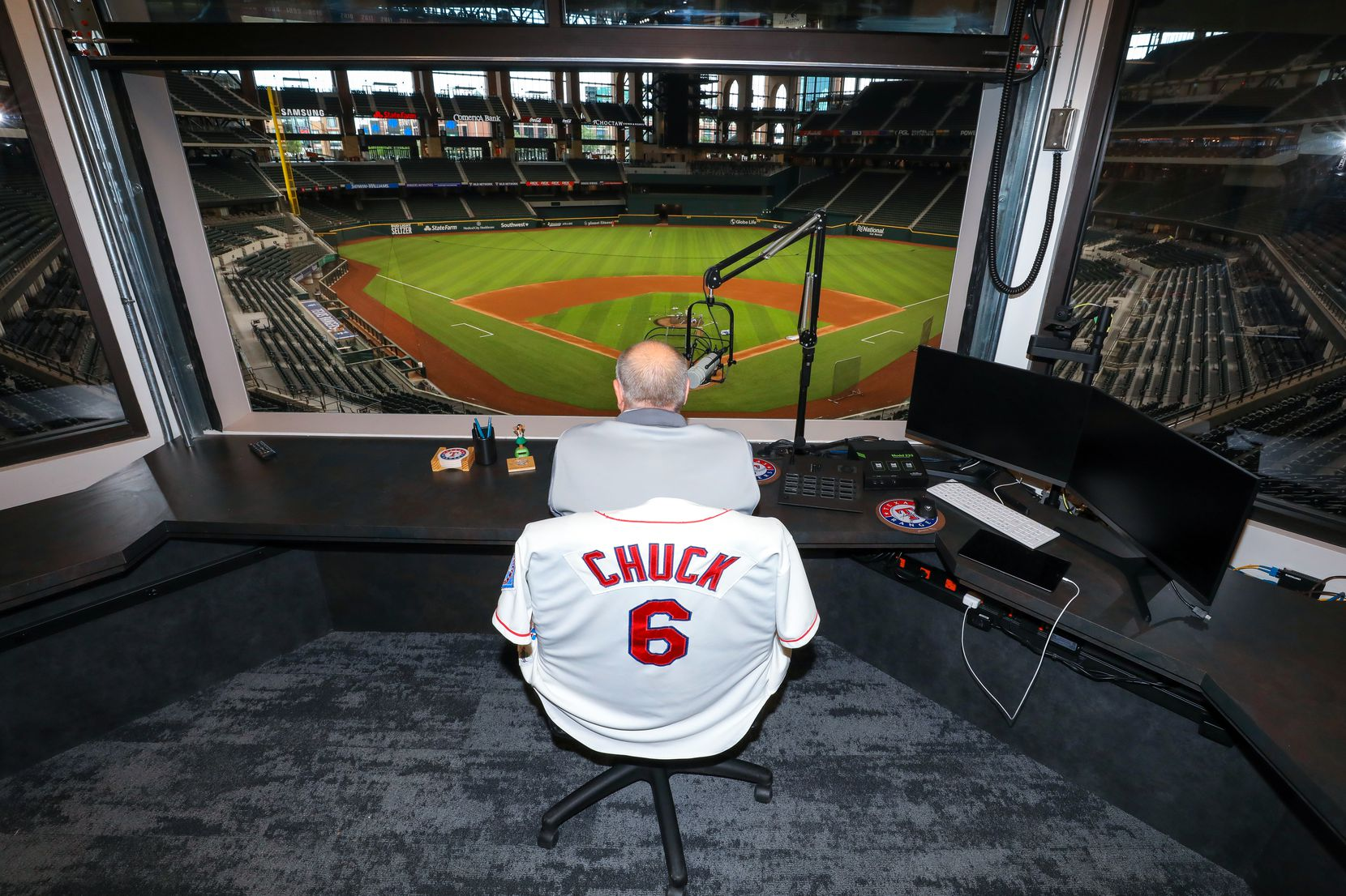 ARLINGTON, TX - MAY 27:  Chuck Morgan, the public address announcer for the Texas Rangers sits in his booth at Globe Life Field on Wednesday, May 27, 2020 in Arlington, Texas.