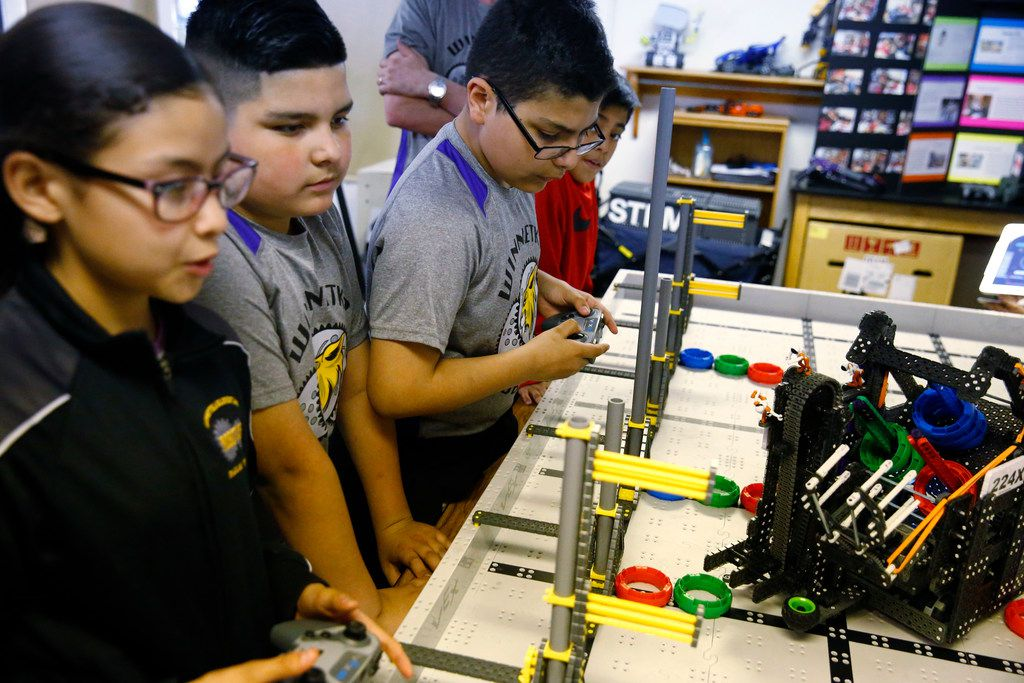 Cassandra Gayton (from left), Anthony Vargas, Giovany Ortega and Erick Mendoza use robots to pick up points as they practice for the Vex Robotics World Championship.