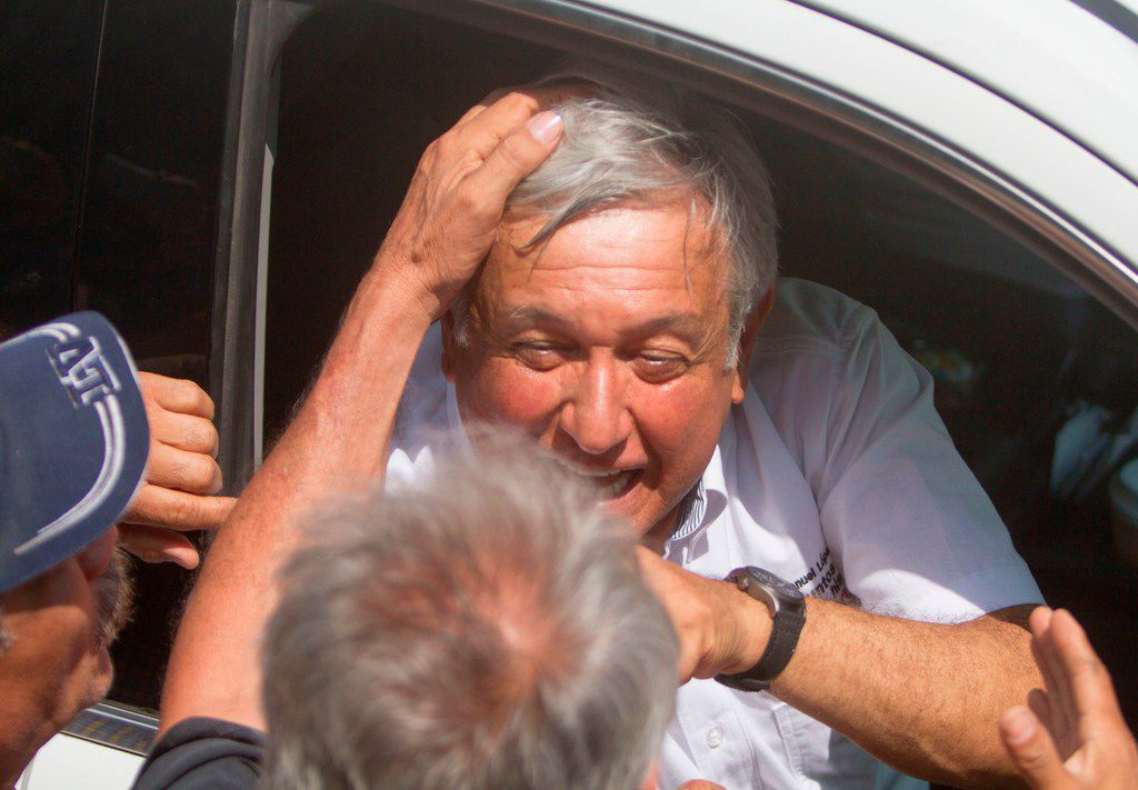 Mexico's presidential candidate for the MORENA party, Andres Manuel Lopez Obrador, greets a supporter during a campaign rally in Rio Bravo, Tamaulipas, Mexico, on April 6, 2018.  (JULIO CESAR AGUILAR/AFP/Getty Images)