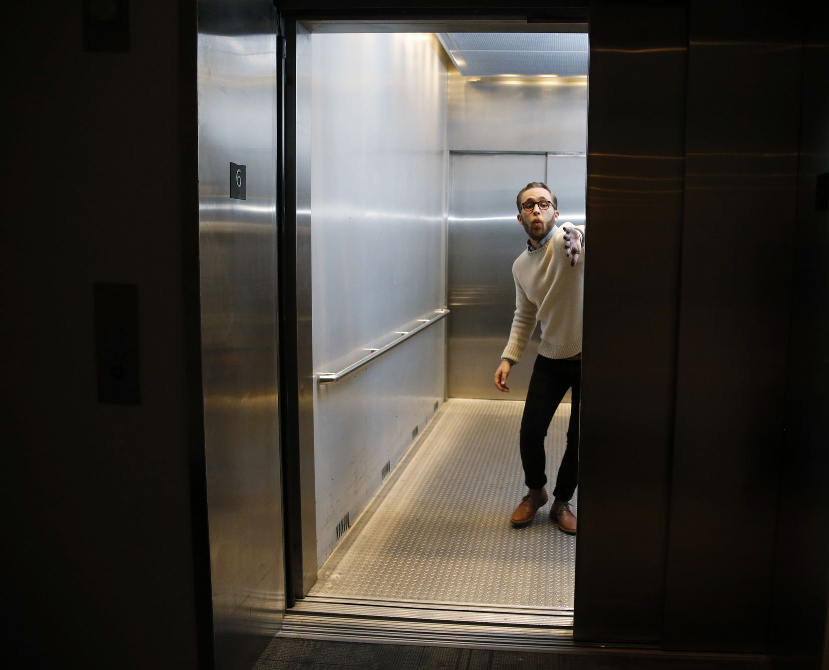 """Jake Nice, producer and director of the play, """"Slide By,"""" clowns around in the Wyly Theatre elevator that the Elevator Project is named after. Nice is one of the few independent theater artists to ever win a slot in the series."""