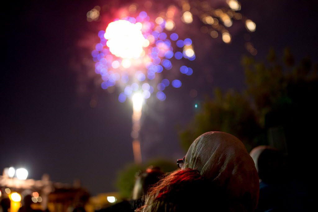 Yamna Goughbar, of Hurst, Texas, watches fireworks from Southlake Town Square in this 2016 file photo. (Ting Shen/The Dallas Morning News)