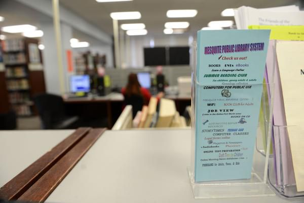 Pamphlets show the list of electronic services and online classes at the Mesquite Main Library.