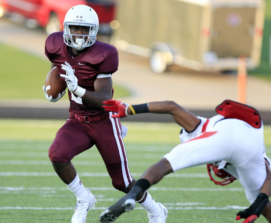 Plano Senior High running back Brandon Stephens (2) eludes an Irving MacArthur High defender in route to a gain during the first quarter of a UIL high school football game Sept. 5 at Tom Kimbrough Stadium in Murphy. Plano shut MacArthur out, 28-0.