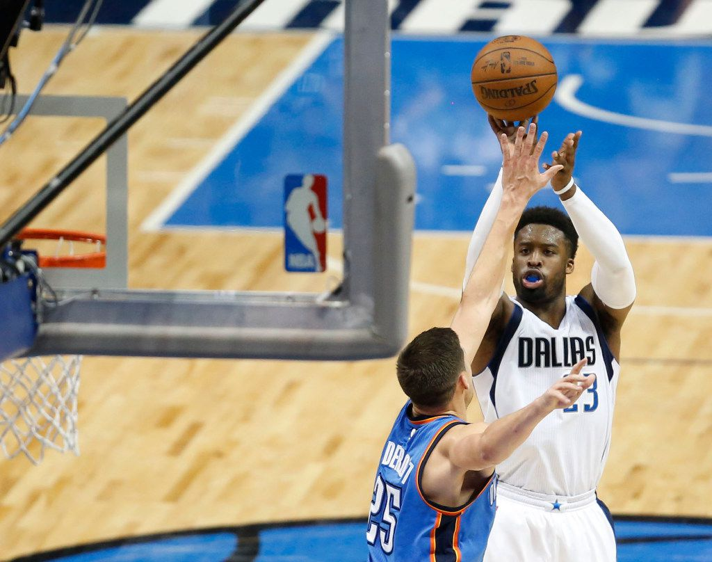 Dallas Mavericks guard Wesley Matthews (23) shoots over Oklahoma City Thunder forward Doug McDermott (25) during the first half of play at American Airlines Center in Dallas on Sunday, March 5, 2017. (Vernon Bryant/The Dallas Morning News)