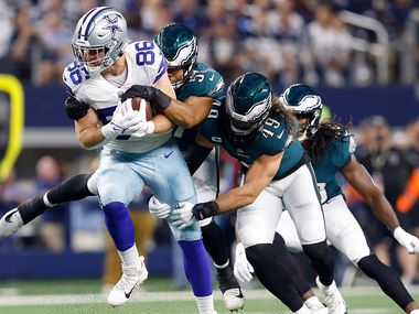 Dallas Cowboys tight end Dalton Schultz (86) is tackled by Philadelphia Eagles linebackers T.J. Edwards (57) and Alex Singleton (49) during the first quarter at AT&T Stadium in Arlington, Monday, September 27, 2021.