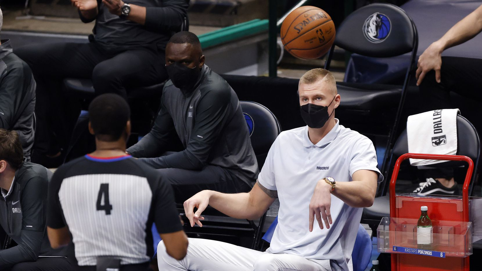 Injured Mavericks center Kristaps Porzingis throws the ball to an official during the Mavericks' game against the Celtics at American Airlines Center in Dallas on Tuesday, Feb. 23, 2021.
