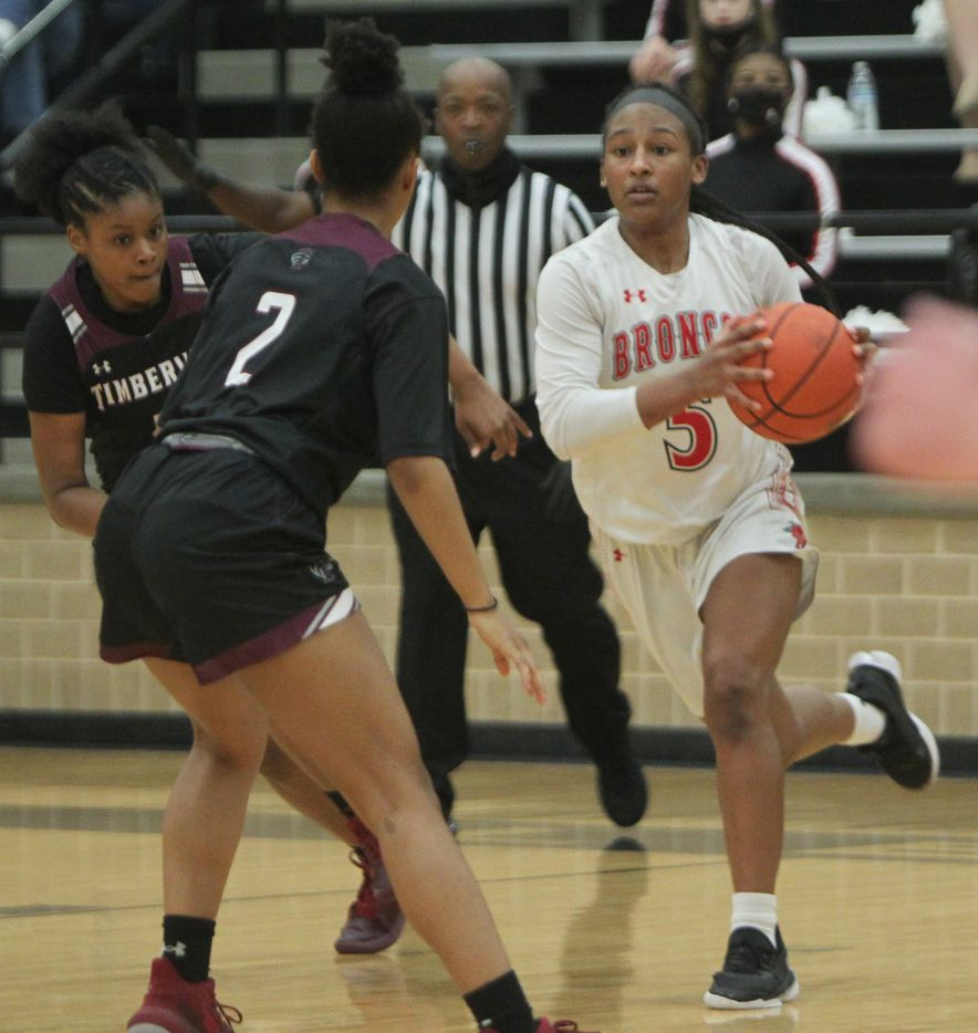 Mansfield Legacy guard Savannah Catalon (5) eyes the defense of Mansfield Timberview's Sa'Raiya Atkinson (2) during first half action. The two teams played their District 8-5A girls basketball game at Mansfield Legacy High school on January 22 , 2021. (Steve Hamm/ Special Contributor)