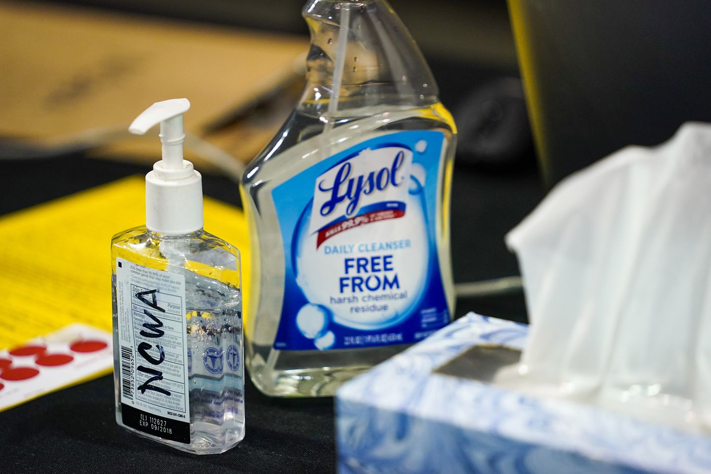 Bottles of hand sanitizer and disinfectant rest on a scorers table during the NCWA national championships at the Allen Events Center on Friday, March 13, 2020, in Allen, Texas..