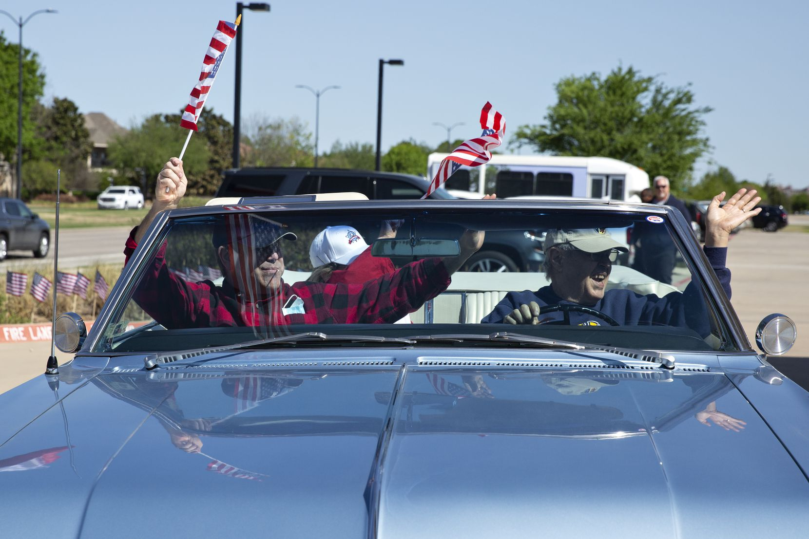People decked out their vehicles with flags, streamers, balloons and signs for the parade.
