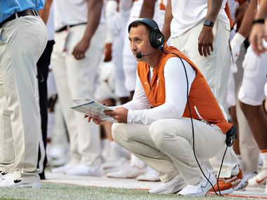 Head Coach Steve Sarkisian of the Texas Longhorns watches the game on the sidelines in the first half of a game against the Arkansas Razorbacks at Donald W. Reynolds Razorback Stadium on September 11, 2021 in Fayetteville, Arkansas.