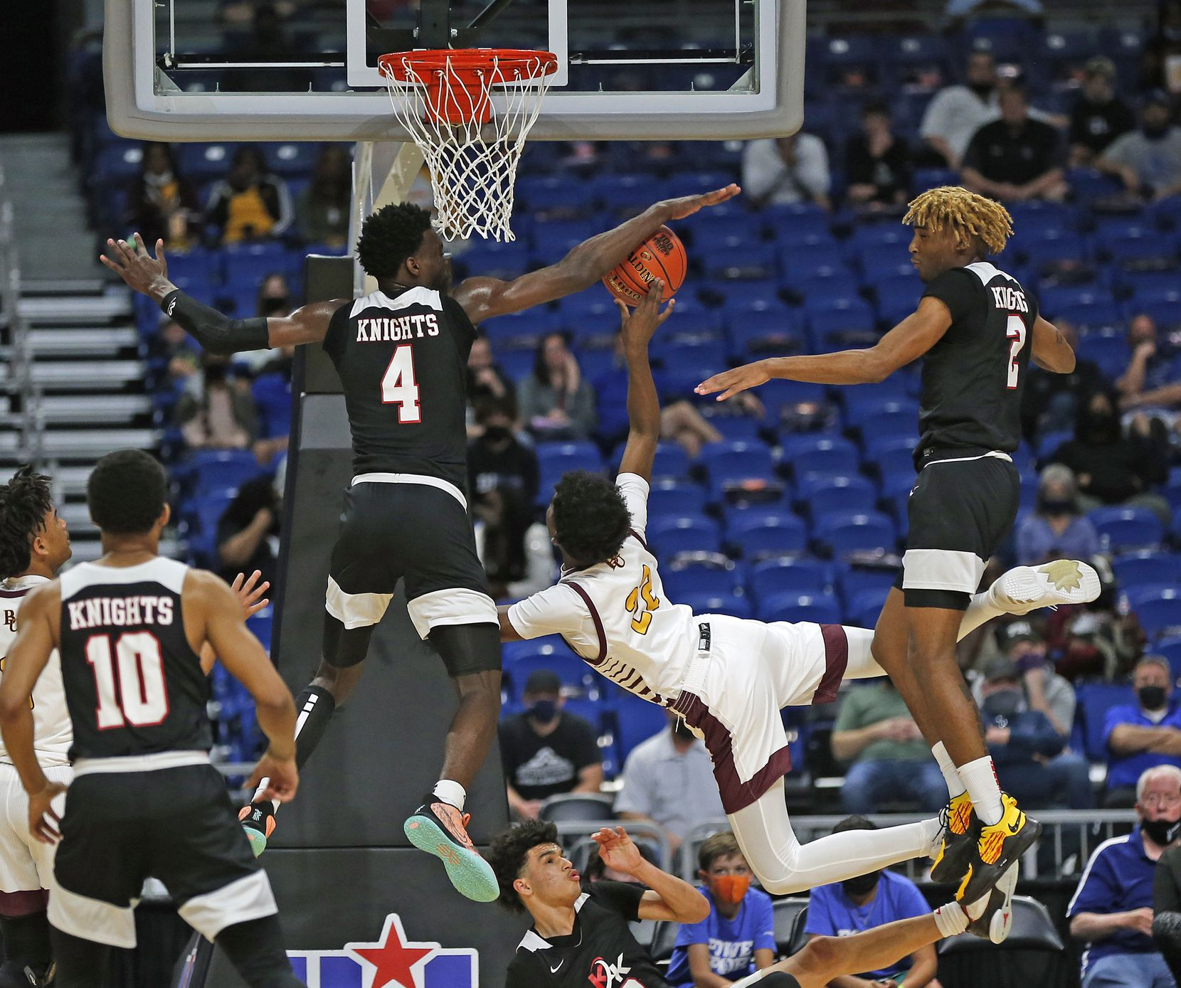 Dallas Kimball Kyron Henderson #4 blocks shot of Beaumont United Clarence Paiya #22. UIL boys Class 5A basketball state championship game on Friday, March 12, 2021 at the Alamodome.