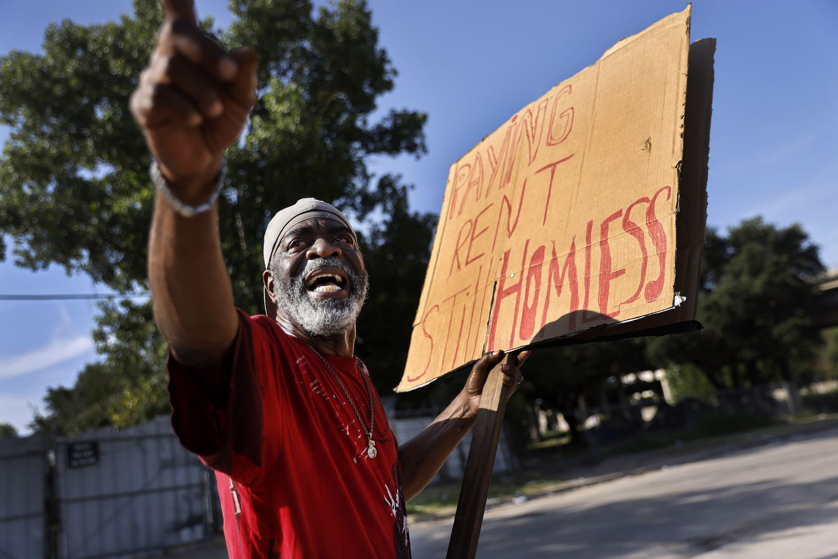 David Andrews talked about his living conditions as he protested July 27 outside The Cottages at Hickory Crossing, where he lives near downtown Dallas.