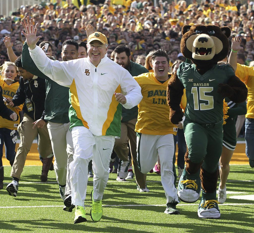When he was president of Baylor University, Ken Starr ran out on the field before the Bears football team took on Texas in 2015. (Jerry Larson/Waco Tribune-Herald)