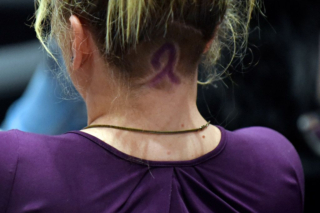 Williams had a purple ribbon — symbolizing domestic violence awareness — on the back of her head at the meeting.