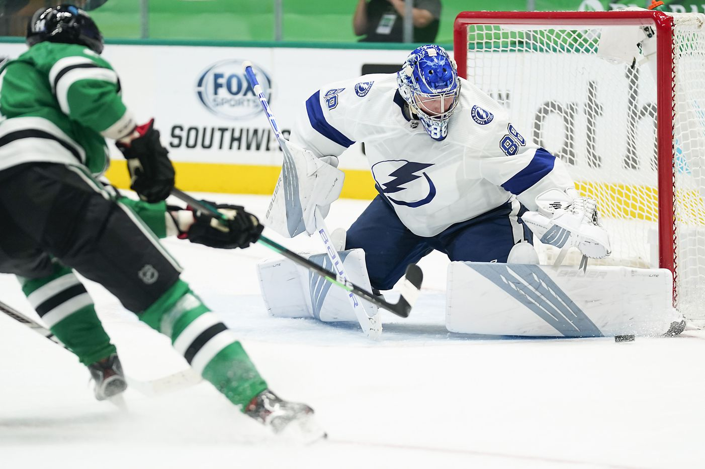 Tampa Bay Lightning goaltender Andrei Vasilevskiy (88) makes a save on a shot by Dallas Stars left wing Jamie Benn (14) during the third period of an NHL hockey game at the American Airlines Center on Thursday, March 25, 2021, in Dallas. The Stars won the game 4-3. (Smiley N. Pool/The Dallas Morning News)