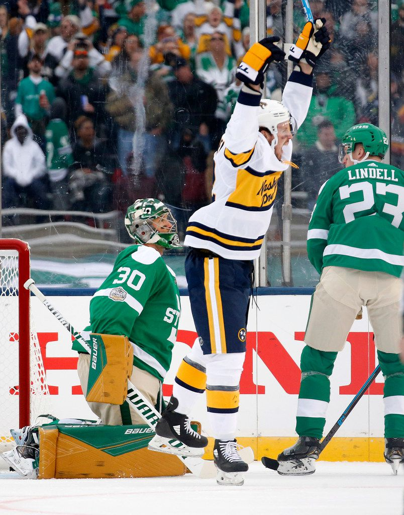 Nashville Predators center Ryan Johansen (92) celebrates a first period goal in front of Dallas Stars goaltender Ben Bishop (30) in the NHL Winter Classic hockey game at the Cotton Bowl in Dallas, Wednesday, January 1, 2019. (Tom Fox/The Dallas Morning News)
