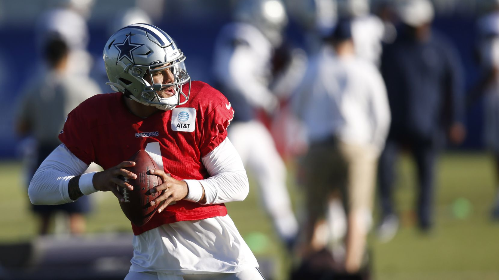 Dallas Cowboys quarterback Dak Prescott (4) runs through a drill during training camp at the Dallas Cowboys headquarters at The Star in Frisco, Texas on Thursday, August 20, 2020. (Vernon Bryant/The Dallas Morning News)