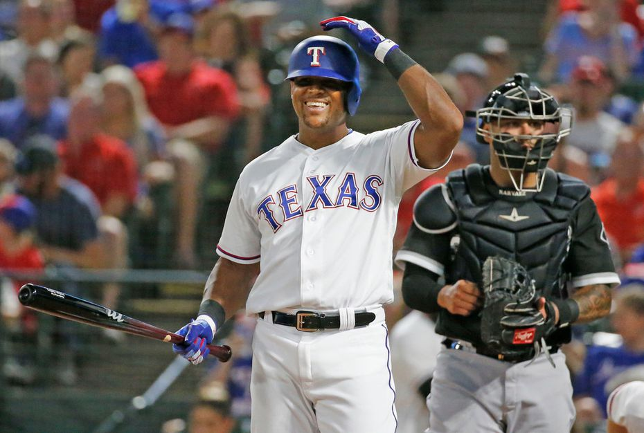 FILE - Adrian Beltre (29) smiles after talking with home plate umpire Joe West during a game against the Chicago White Sox at Globe Life Park in Arlington on June 30, 2018. (Louis DeLuca/The Dallas Morning News)
