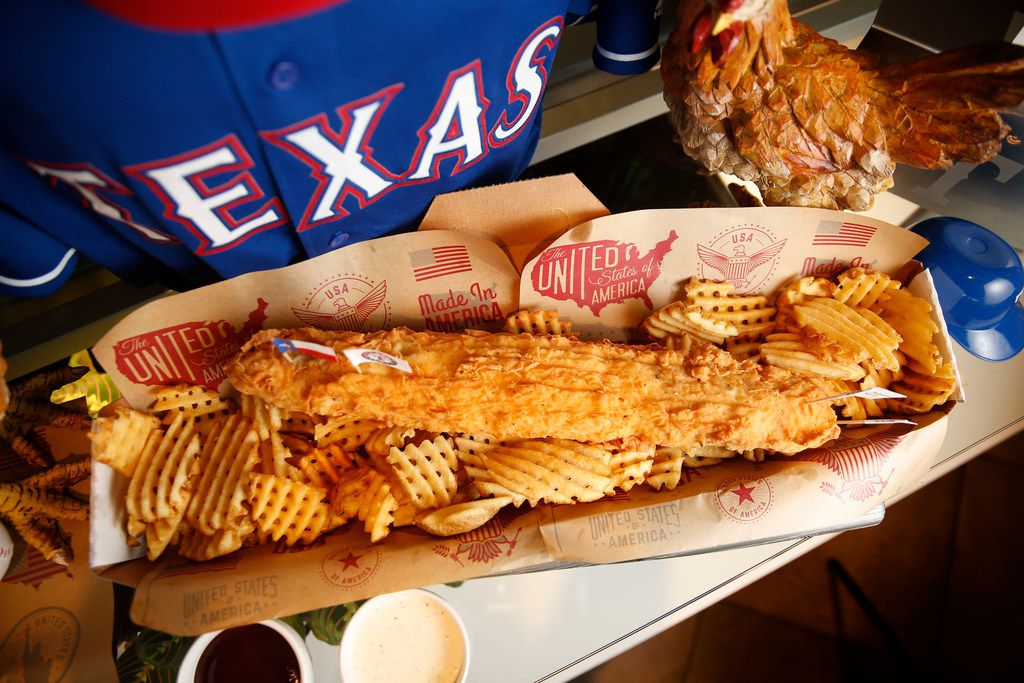 The Fowl Pole, a 2-pound chicken tender, is the largest new concessions item at Globe Life Park in Arlington this season.