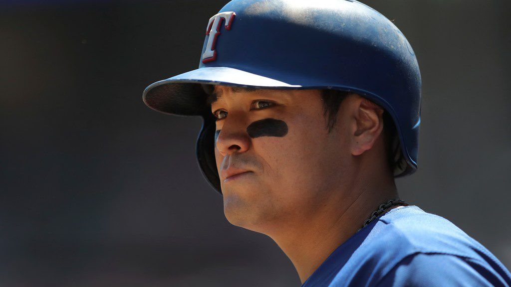 Texas Rangers' Shin-Soo Choo is seen in the dugout during the seventh inning of a baseball game against the Detroit Tigers, Sunday, July 8, 2018, in Detroit. (AP Photo/Carlos Osorio)