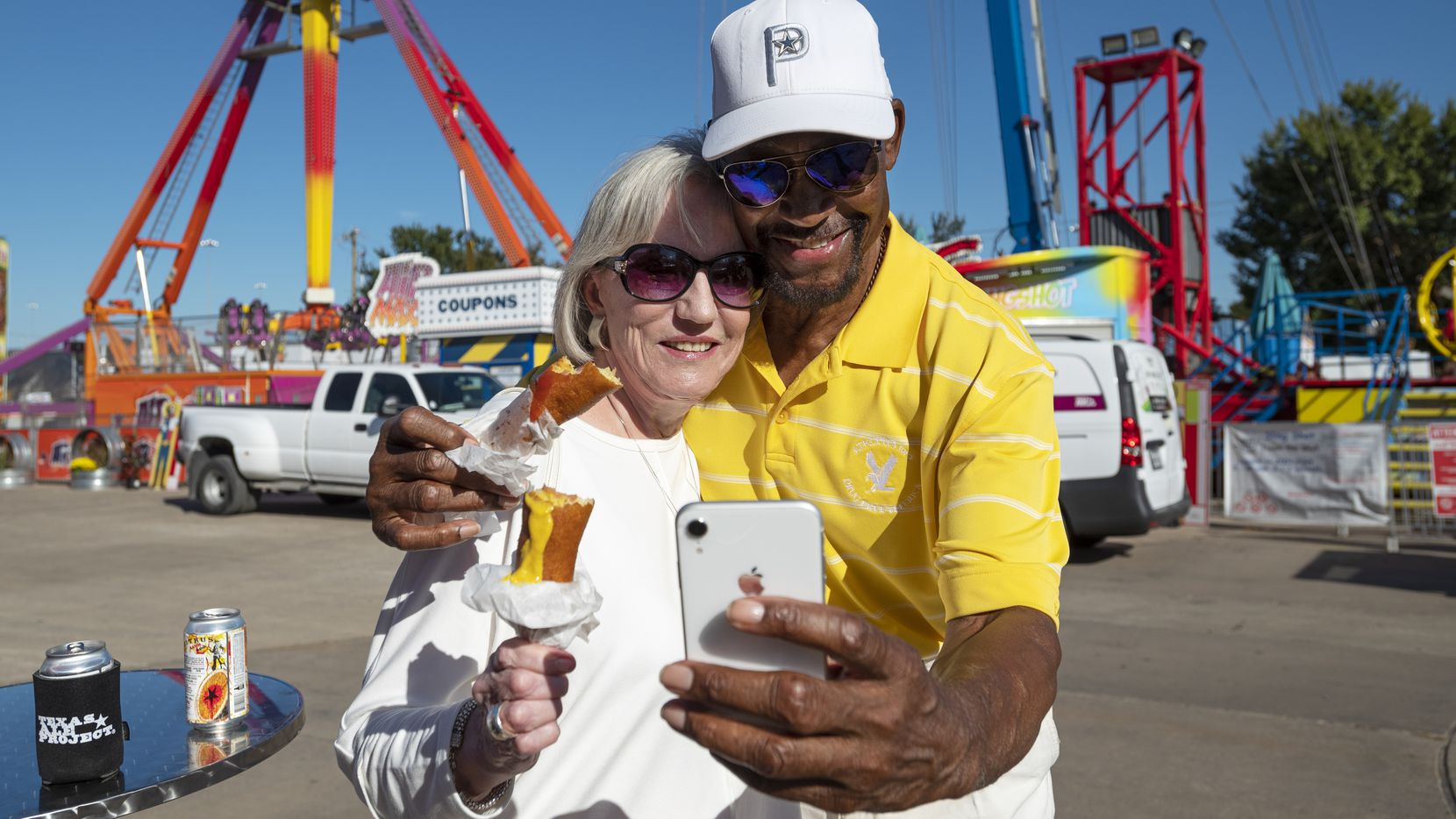 Carole Rhodes and Preston Pearson take a selfie together with their Fletcher's Corny Dogs at the State Fair of Texas during a Dallas Morning News food event for subscribers on Thursday, Sept. 23, 2021.