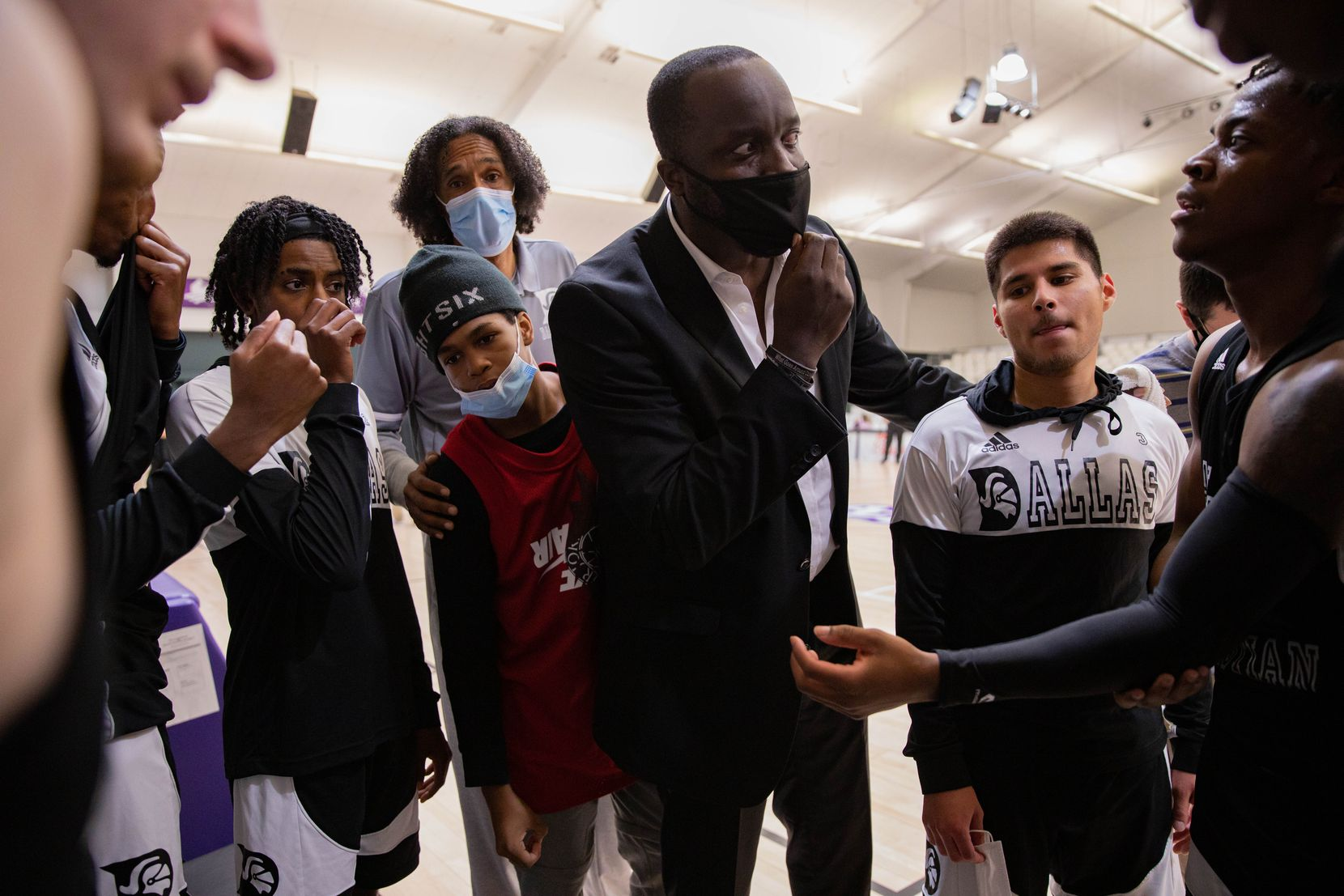Dallas Christian College basketball coach Dwight Coleman (center right) huddles with his team before playing against Abilene Christian University, a NCAA Division I team, in Abilene on Tuesday, Dec. 29, 2020. (Juan Figueroa/ The Dallas Morning News)