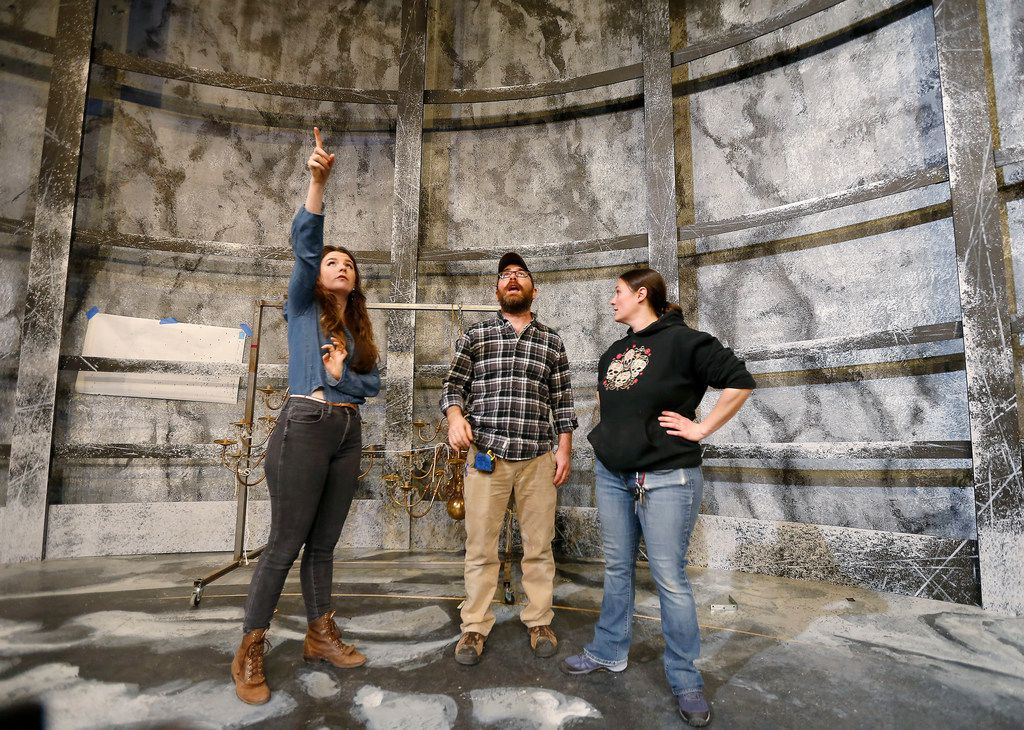 SMU graduate student Amelia Bransky (left) talks with technical director Matt Norman (center) and master electrician Nicole Iannaccone onstage at Kalita Humphreys Theater in Dallas. She designed the set of Frankenstein.
