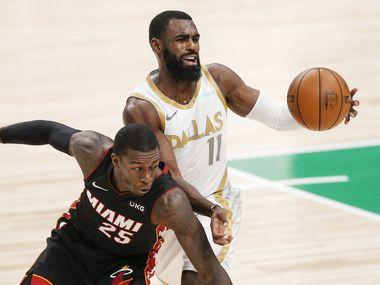 Dallas Mavericks guard Tim Hardaway Jr. (11) battles Miami Heat guard Kendrick Nunn (25) for space during the second half of an NBA basketball game, Friday, January 1, 2021.  Dallas won 93-83. (Brandon Wade/Special Contributor)