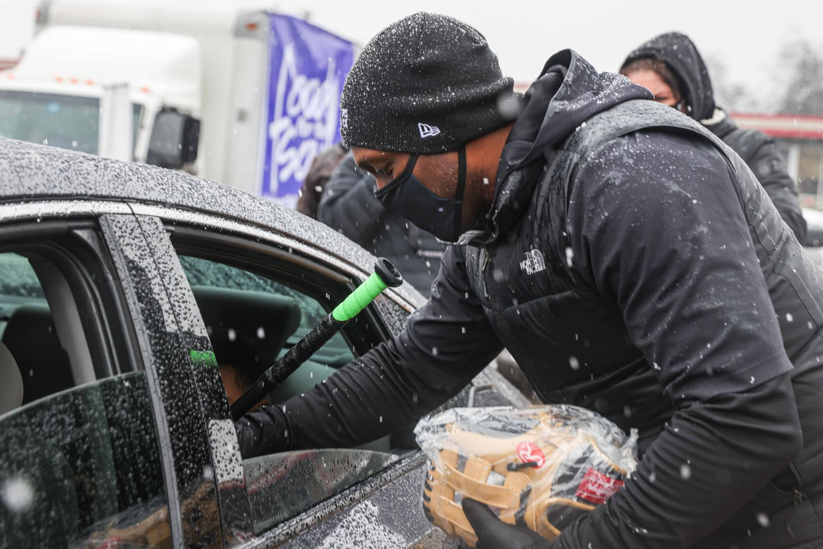 Former professional baseball center fielder and right fielder Torii Hunter, gives baseball equipment as part of the donations made by the MLB Players Alliance in Oak Cliff on Sunday, January 10, 2021.