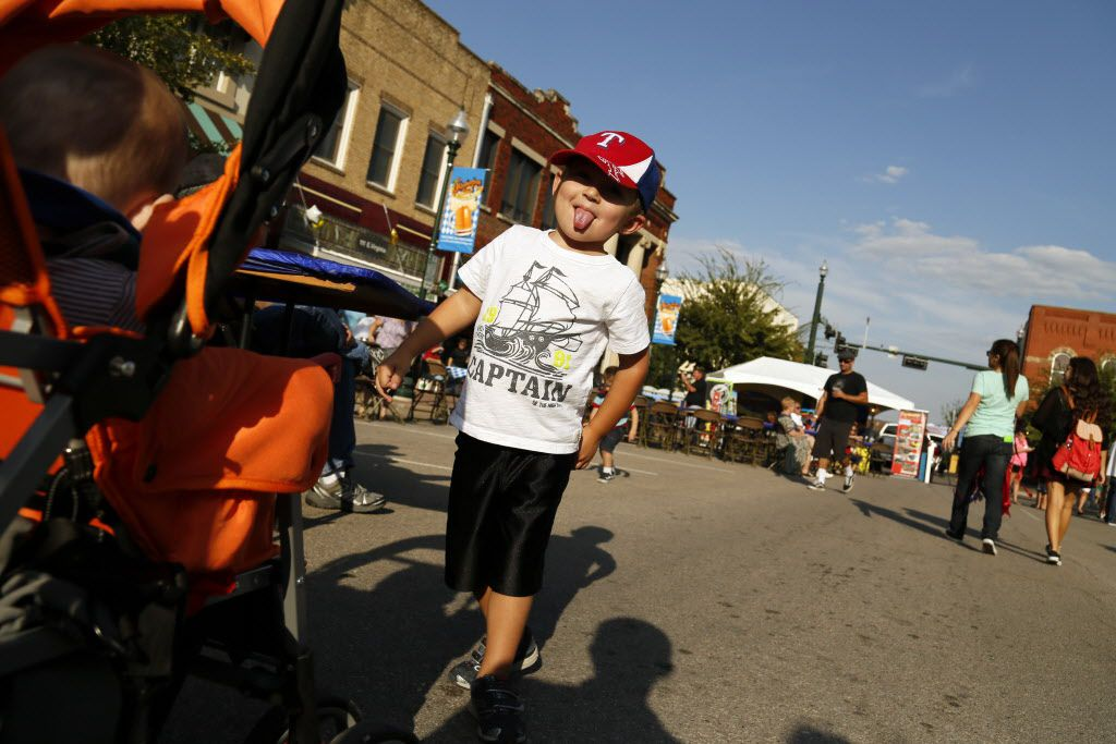 Brady Byers, 3, of McKinney, has a fun time with his family during McKinney Oktoberfest.