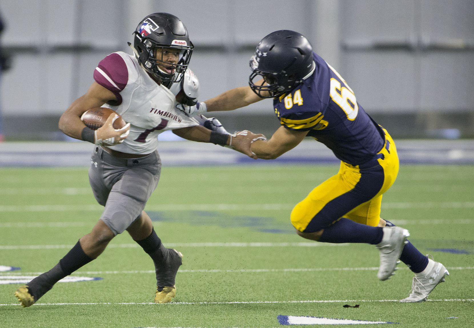 Timberview running back Stacy Sneed (1) tries to break free from Highland Park defensive back John Beecherl (64) during a high school football game at Ford Center at The Star in Frisco, Texas on Saturday, December 1, 2018. The Highland Park Fighting Scots were beating the Mansfield Timberview Wolves 38 to 0 at the end of the first half. (Daniel Carde/The Dallas Morning News)