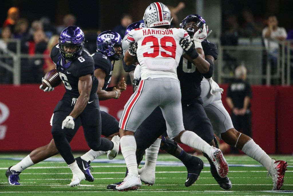 FILE - TCU running back Darius Anderson (6) makes a break during the AdvoCare Showdown between the Ohio State Buckeyes and the Texas Christian University Horned Frogs on Saturday, Sept. 15, 2018 at AT&T Stadium in Arlington, Texas. (Ryan Michalesko/The Dallas Morning News)