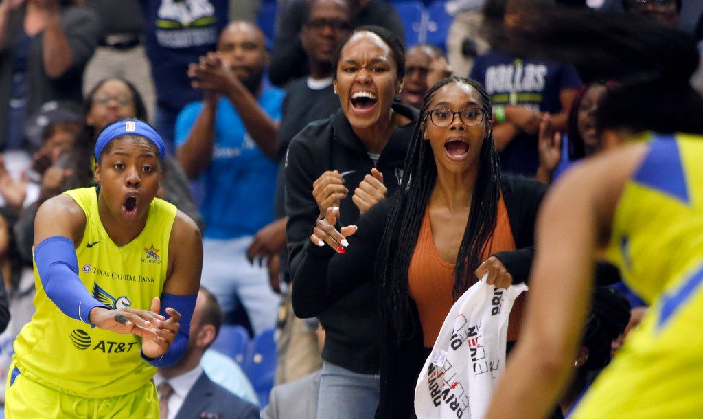 There certainly were no players sitting on the bench during the final minute of play as guard Arike Ogunbowale (24), left, forward Azura Stevens, and Tayler Hill offer plenty of vocal support following a turnover. The Wings defeated the Minnesota Lynx, 89-86 before a near-capacity crowd. The two teams played their WNBA game at UT-Arlington's College Park Center in Arlington on June, 30, 2019.
