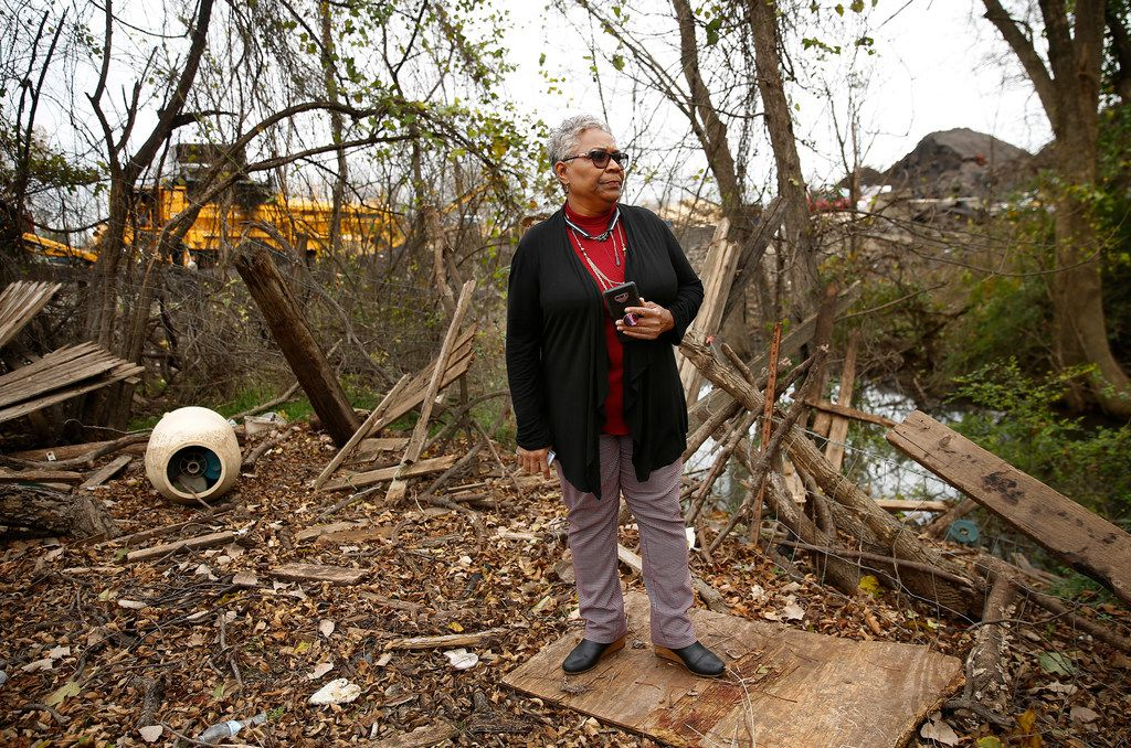 Homeowner Marsha Jackson stands among the debris left over from the fall's flooding.