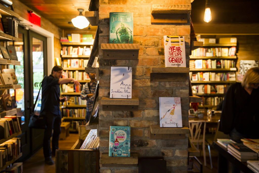 """Patrons browse books before an event with authors Nick Scott and Noa Gavin for their novel """"Practical Applications for Multiverse Theory"""" at The Wild Detectives on Tuesday, April 19, 2016, in Dallas."""