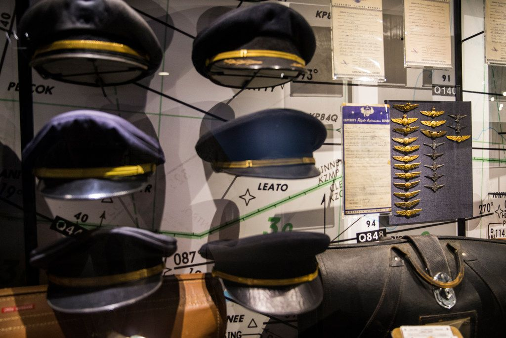 Captains' caps and wings on display at the American Airlines C.R. Smith Museum on Thursday, August 23, 2018 in Fort Worth. The newly renovated museum reopens Labor Day Weekend. (Ryan Michalesko/The Dallas Morning News)