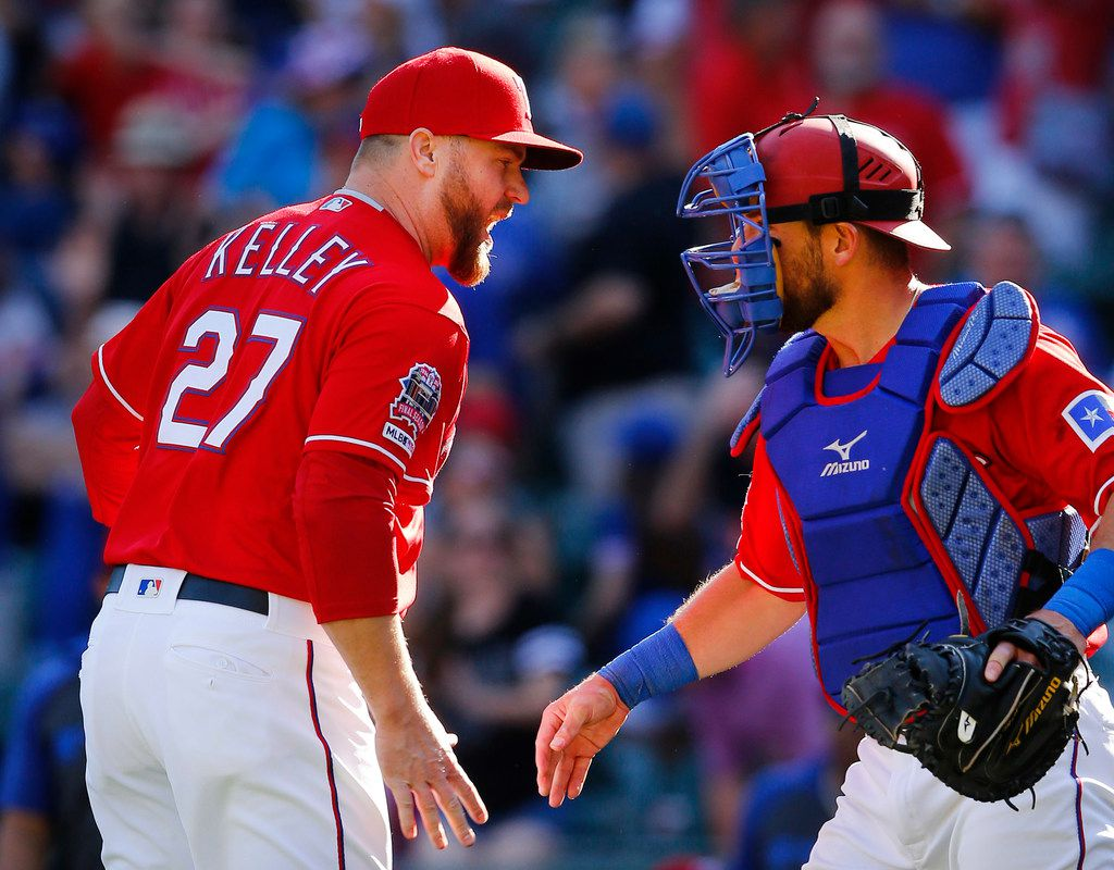 Texas Rangers relief pitcher Shawn Kelley is congratulated by catcher Jeff Mathis after getting the save against the Houston Astros, 11-10, at Globe Life Park in Arlington, Texas, April 21, 2019. (Tom Fox/The Dallas Morning News)