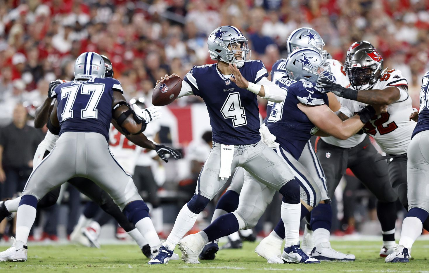 Dallas Cowboys quarterback Dak Prescott (4) throws from the pocket in the first quarter against the Tampa Bay Buccaneers at Raymond James Stadium in Tampa, Florida, Thursday, September 9, 2021. The Cowboys faced the Tampa Bay Buccaneers in the NFL season opener. (Tom Fox/The Dallas Morning News)