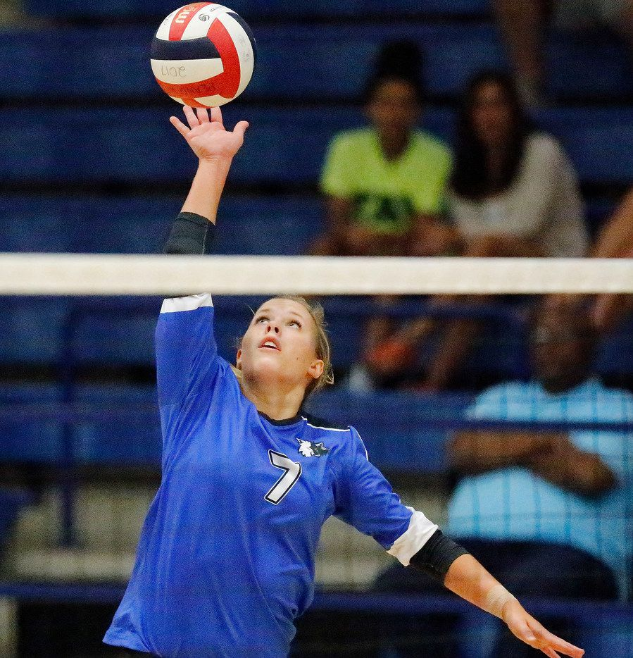 Plano West outside hitter Jill Pressly (7) makes a hit in game two as Plano West High School hosted Hebron High School in Plano on Tuesday, August 7, 2018. (Stewart F. House/Special Contributor)