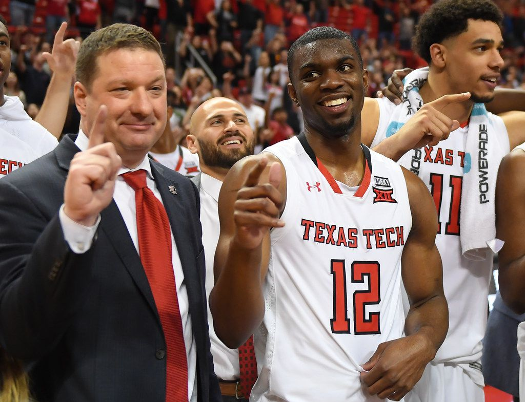 LUBBOCK, TX - MARCH 3: Head coach Chris Beard and Keenan Evans #12 of the Texas Tech Red Raiders stand on the court after the game against the TCU Horned Frogs on March 3, 2018 at United Supermarket Arena in Lubbock, Texas. Texas Tech defeated TCU 79-75. (Photo by John Weast/Getty Images)